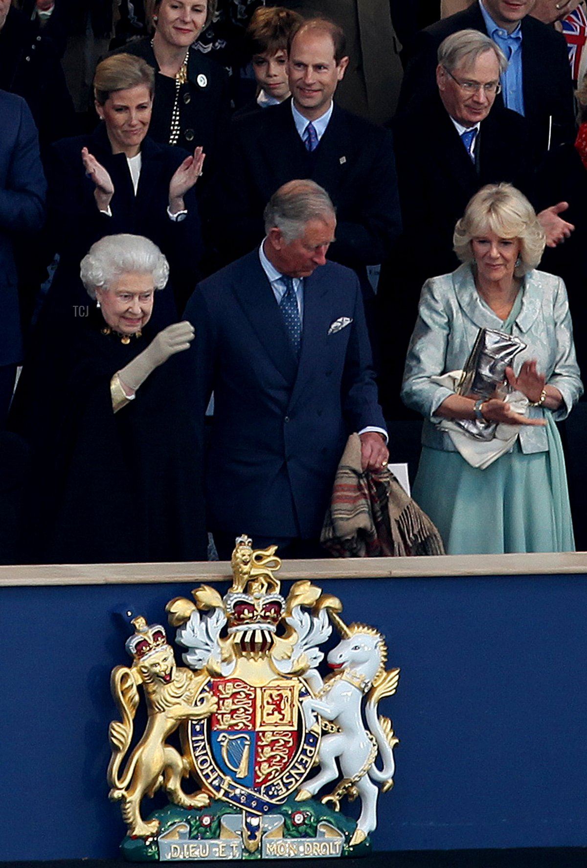 Britain's Queen Elizabeth II (L front row) waves from the Royal Box surrounded by guests including members of the royal family Prince Charles, Prince of Wales (front C), Camilla, Duchess of Cornwall (front R) Sophie, Countess of Wessex (top L), Prince Edward, Earl of Wessex (top C) and Prince Richard, Duke of Gloucester (top R) during the Queen's Diamond Jubilee Concert at Buckingham Palace on June 4, 2012