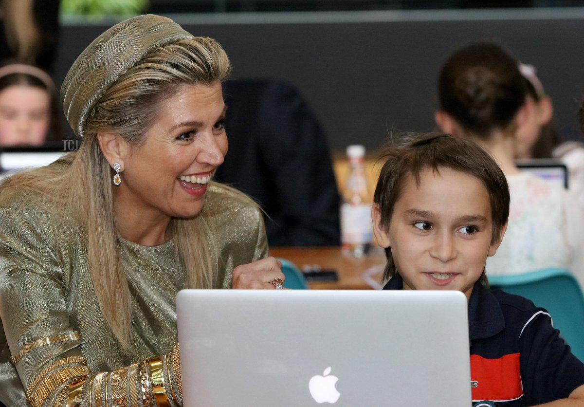 The Netherlands' Queen Maxima (L) chats with kids at CoderDojo, a global movement of free, volunteer-led, community-based computer programming clubs for young people in Dublin on June 12, 2019, on the first day of their three-day State Visit to Ireland