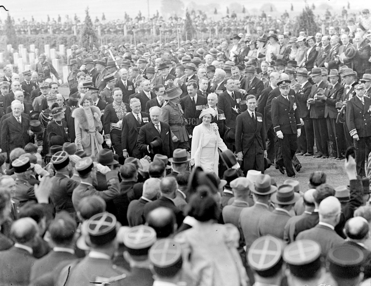 King unveils Australian War Memorial at Villers Bretonneux. The King and Queen attended the last ceremony of their State visit to France, when, in the presence of President Lebrun, his Majesty unveiled the Australian war Memorial at Villers Bretonneux. Photo shows, the King and Queen among Australian ex-servicemen at the service. 22 July 1938
