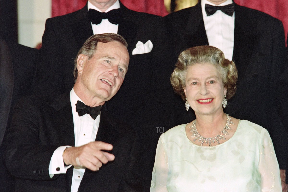 Queen Elizabeth II speaks with US President George Bush during the NATO summit in London on July 5, 1990