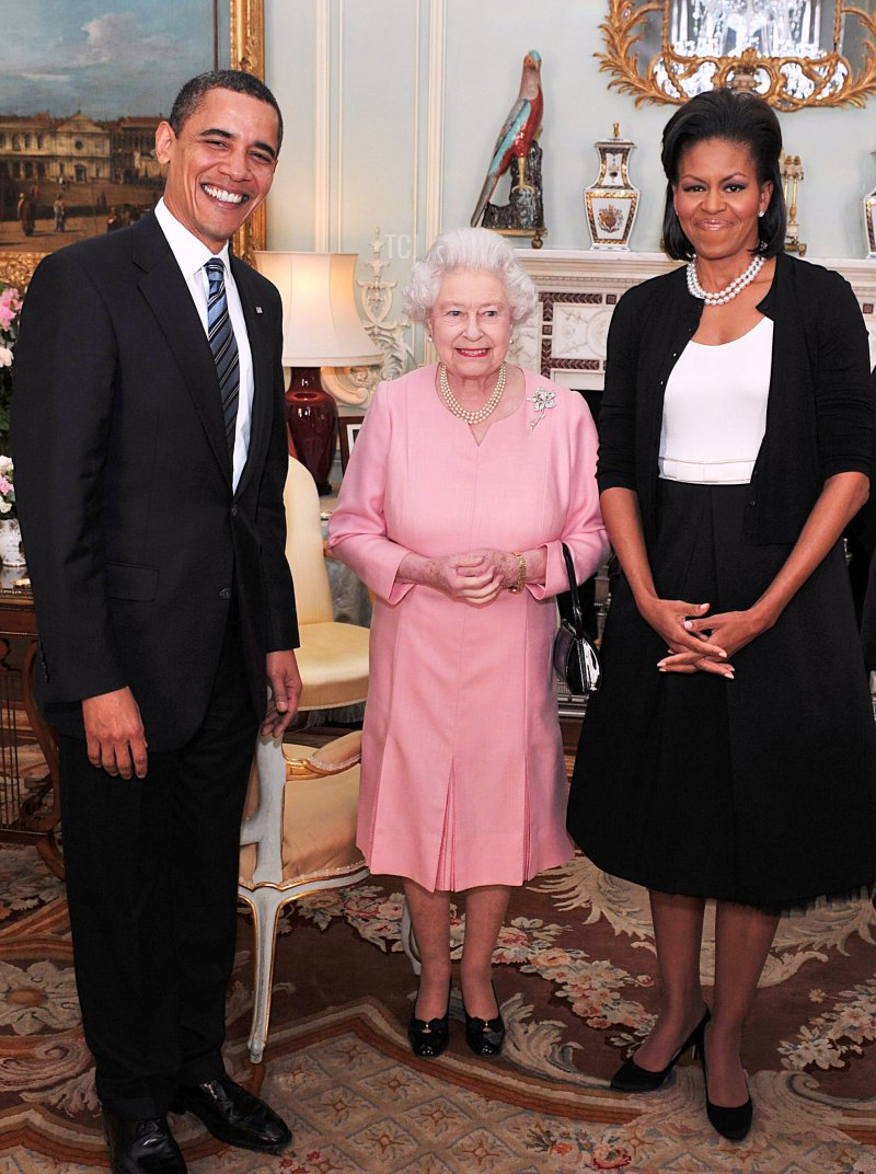 US President Barack Obama and his wife Michelle Obama pose for photographs with Queen Elizabeth II during an audience at Buckingham Palace on April 1, 2009 in London, England