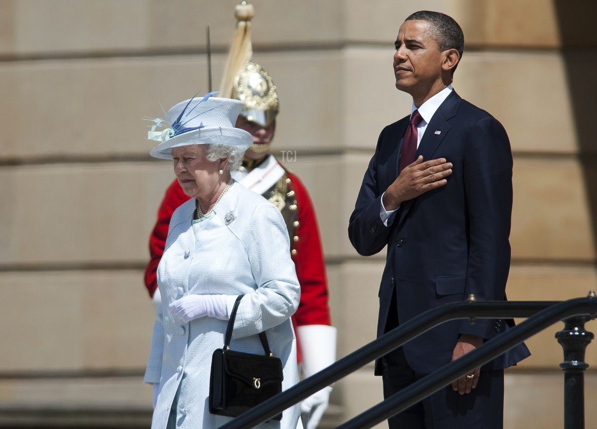 Queen Elizabeth II and US President Barack Obama review an honour guard of the First Battalion Scots Guards at a ceremony of welcome at Buckingham Palace on May 24, 2011 in London, England