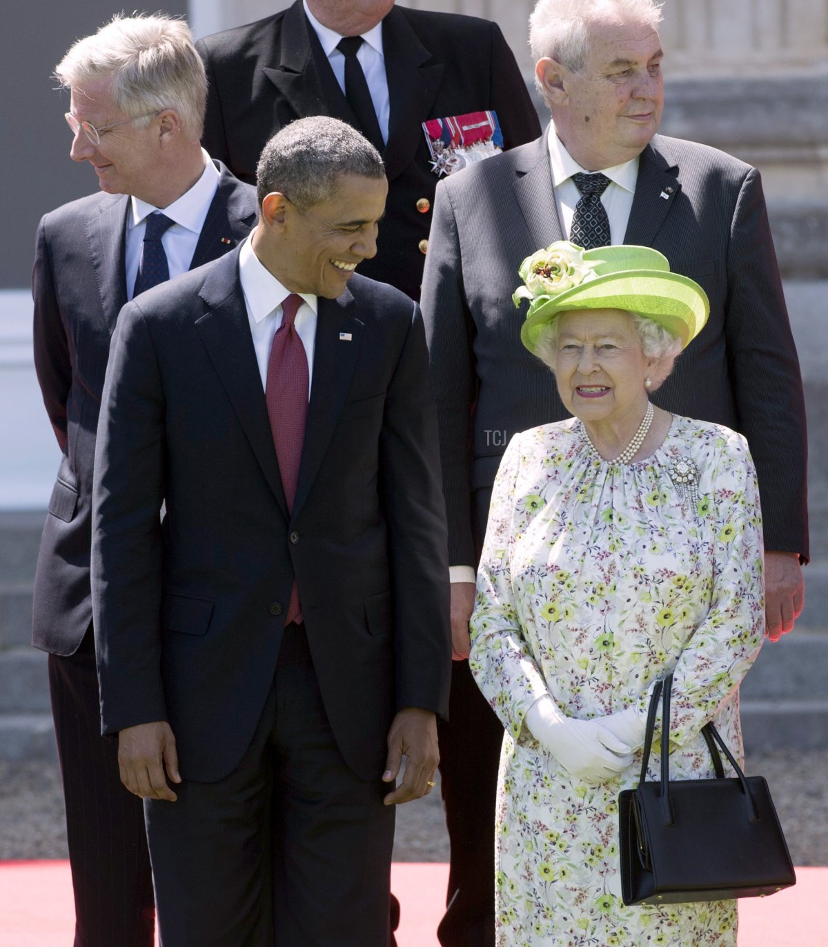 Queen Elizabeth II speaks with US President Barack Obama during a group photo of world leaders attending the D-Day 70th Anniversary ceremonies at Chateau de Benouville in Benouville, France, June 6, 2014