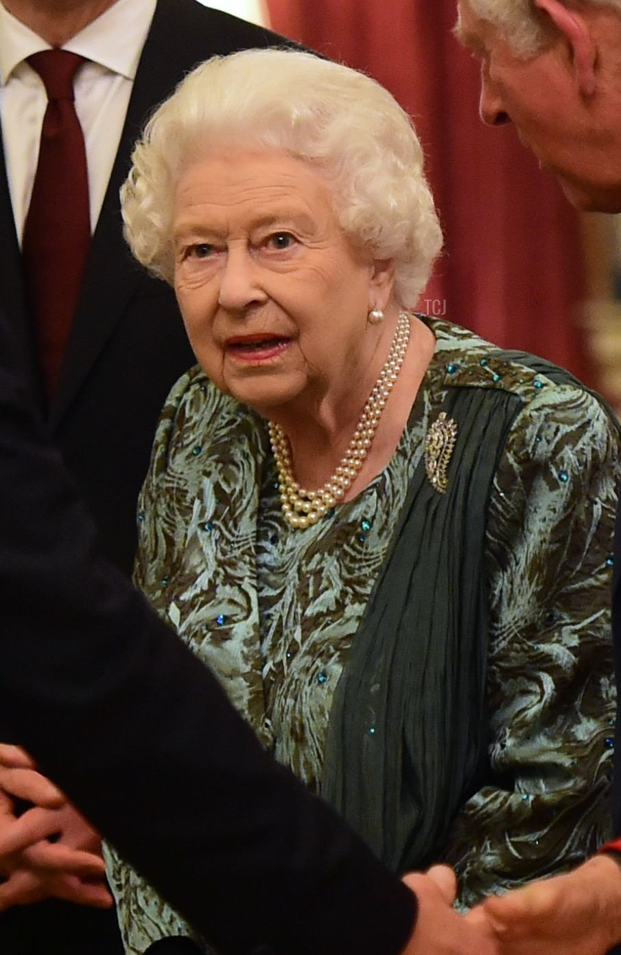 Britain's Queen Elizabeth II (C) speaks with US First Lady Melania Trump (L) and US President Donald Trump (2nd L), Britain's Camilla, Duchess of Cornwall (R) and Britain's Prince Charles, Prince of Wales (2nd R) in Buckingham Palace in central London on December 3, 2019, during a reception hosted by Britain's Queen Elizabeth II ahead of the NATO alliance summit