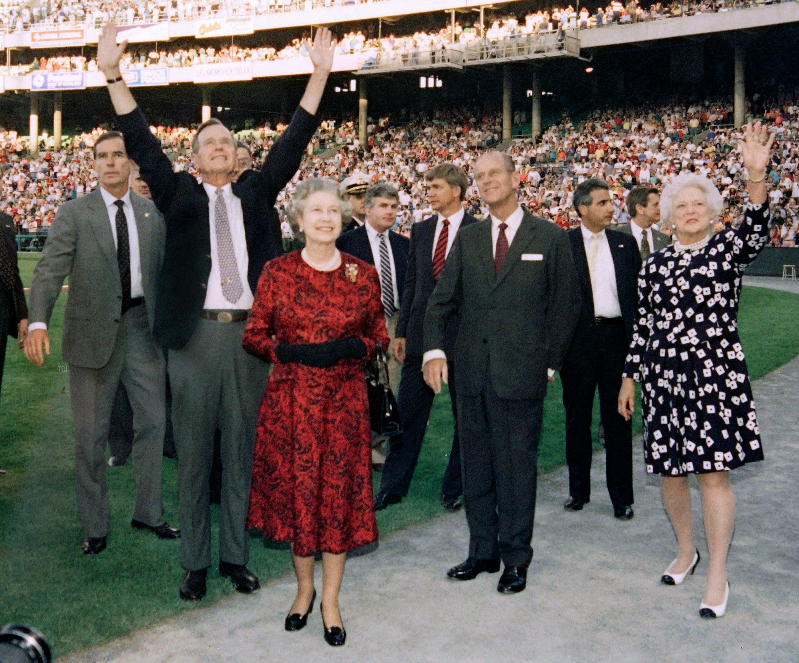 US President George Bush (C), Britain's Queen Elizabeth II (C), Prince Philip, Duke of Edinburgh (4th R) and Barbara Bush (3rd R) wave to the crowd before the start of the Orioles vs. the Oakland Athletics baseball game at the Memorial Stadium in Baltimore on May 15, 1991