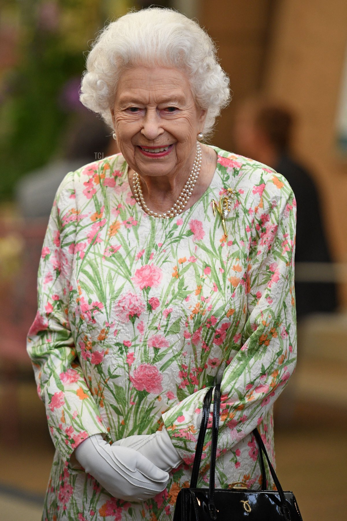 Britain's Queen Elizabeth II smiles as she meets people from communities across Cornwall during an event in celebration of The Big Lunch initiative at The Eden Project, near St Austell in south west England on June 11, 2021
