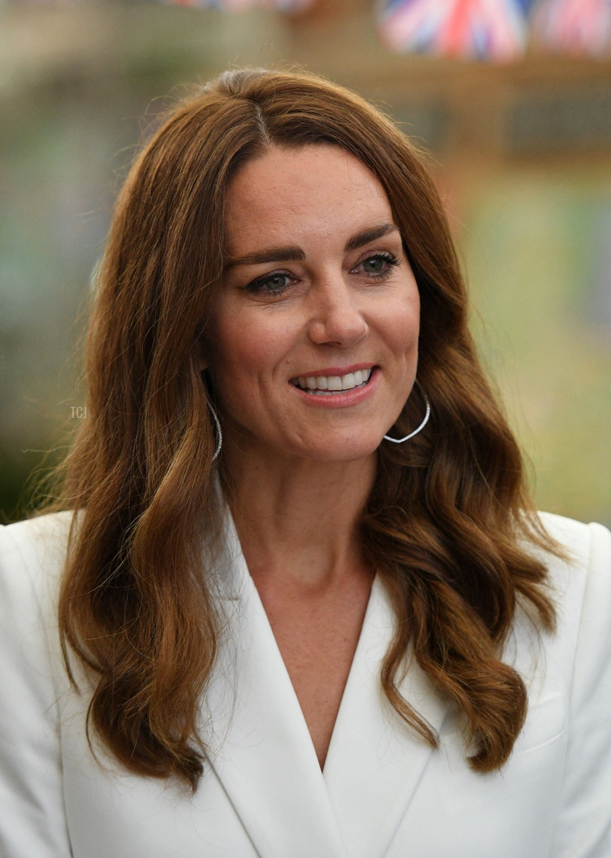 Britain's Catherine, Duchess of Cambridge, smiles as she attends an event with Britain's Queen Elizabeth II in celebration of The Big Lunch initiative at The Eden Project, near St Austell in south west England on June 11, 2021