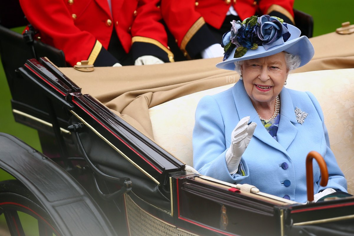 Queen Elizabeth II waves to the crowds as she arrives on day one of Royal Ascot at Ascot Racecourse on June 18, 2019 in Ascot, England