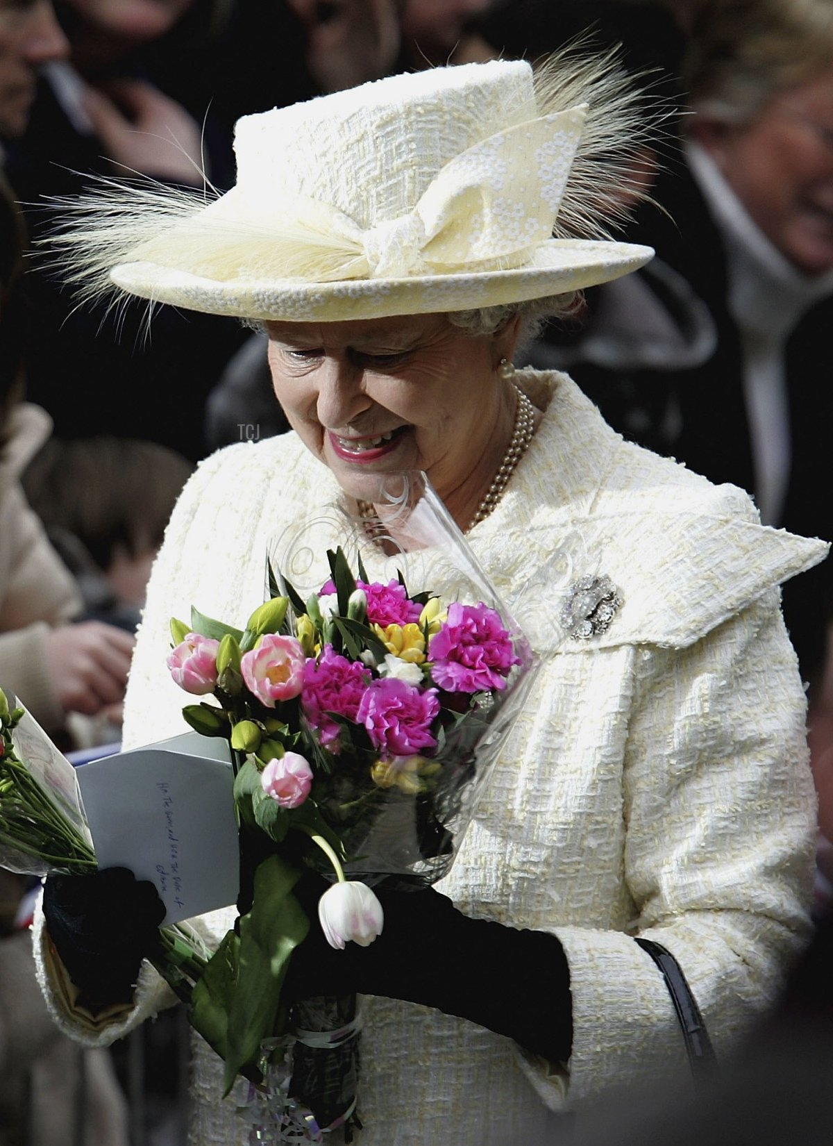 HRH Queen Elizabeth II meets the public as she walks through Guilford High Street on April 13, 2006 in Guilford, England. The Queen and The Duke of Edinburgh were present at the Maundy Service in Guildford Cathedral where she distributed the Royal Maundy to the congregation during the Service