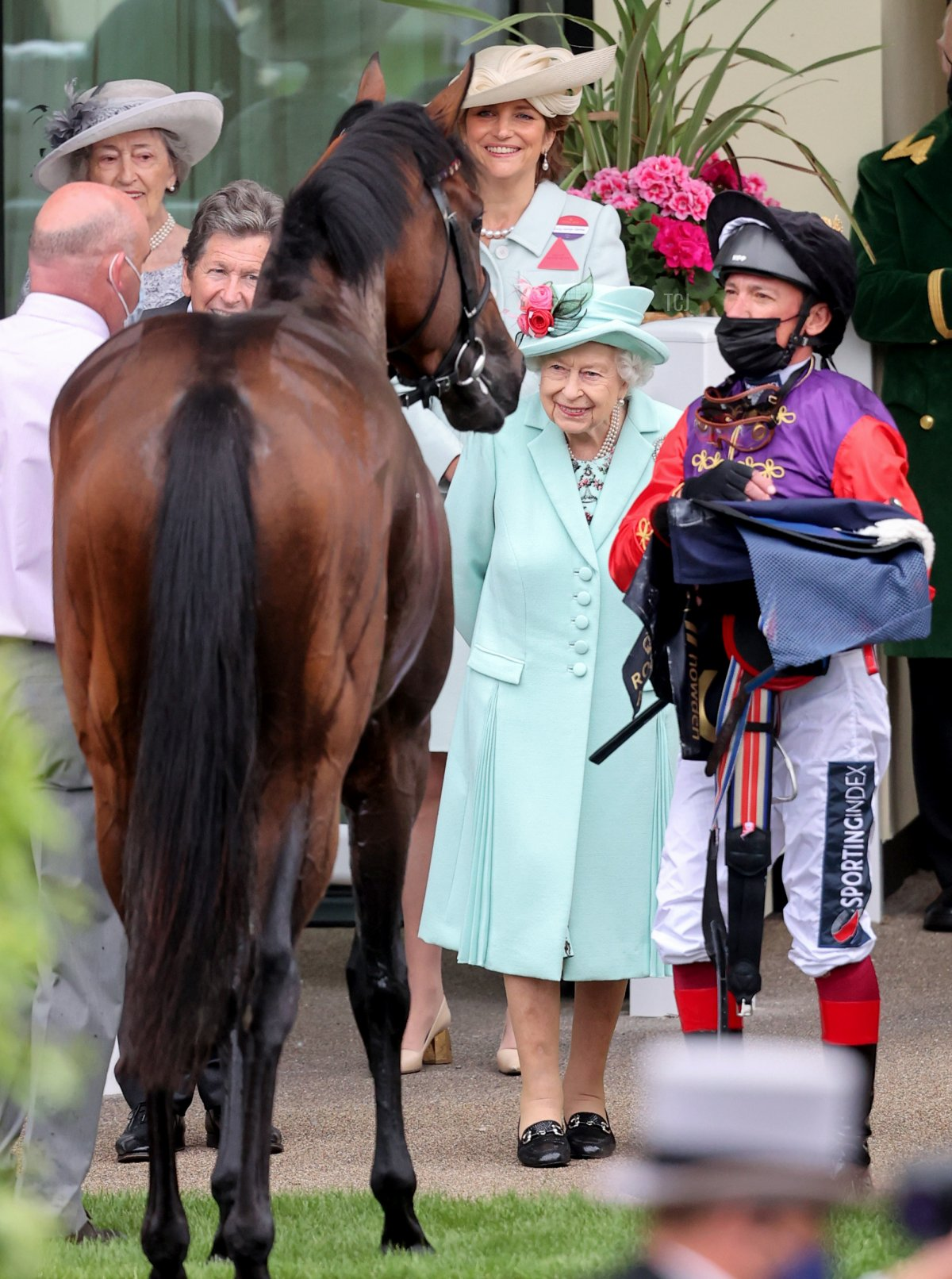 Queen Elizabeth II and Frankie Dettori (R) during Royal Ascot 2021 at Ascot Racecourse on June 19, 2021 in Ascot, England