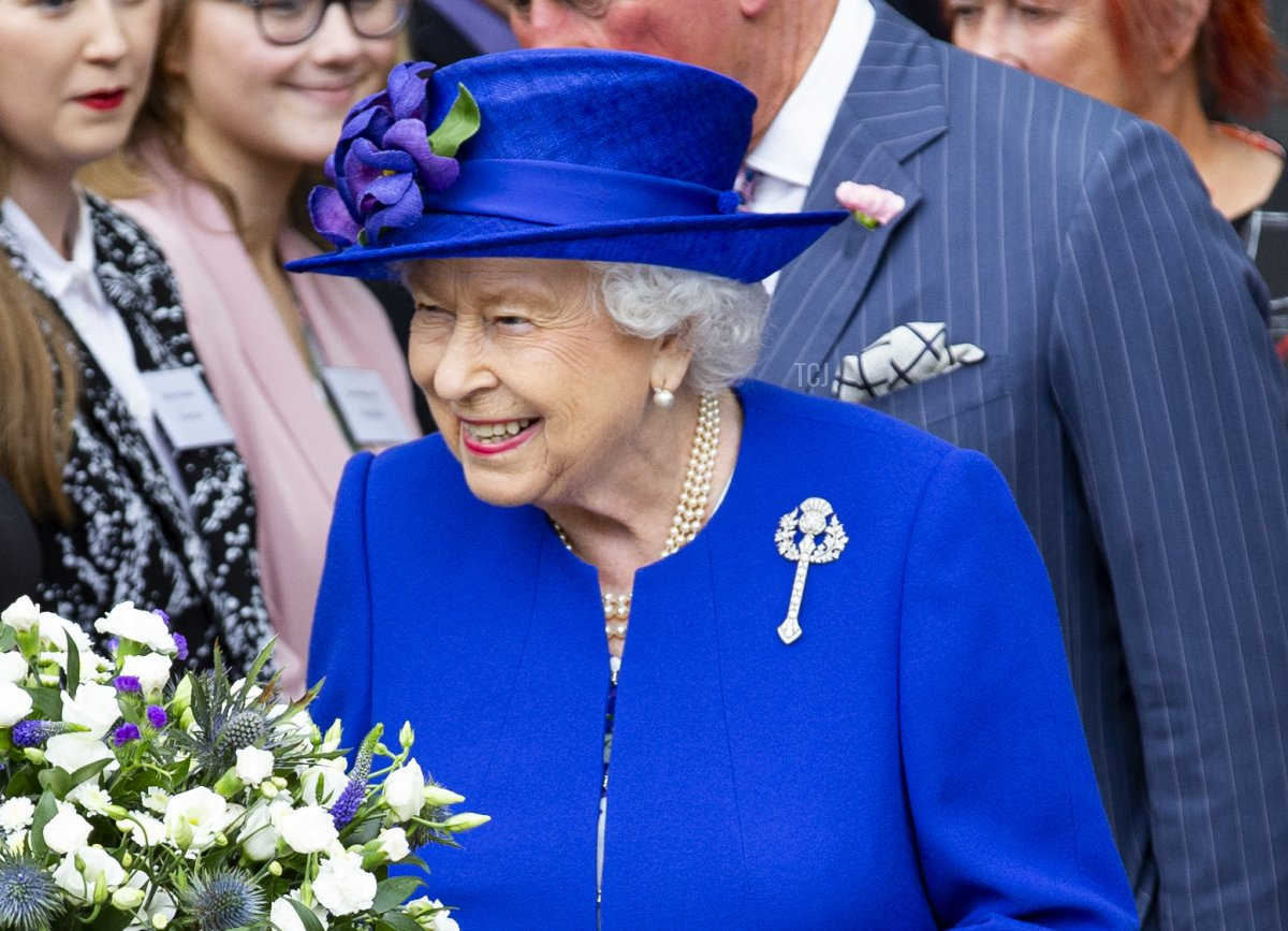 Queen Elizabeth II attends the Scottish Parliaments 20th Anniversary as she receives posey of flowers from Ewan Carmichael aged 13 on June 29, 2019 in Edinburgh, Scotland