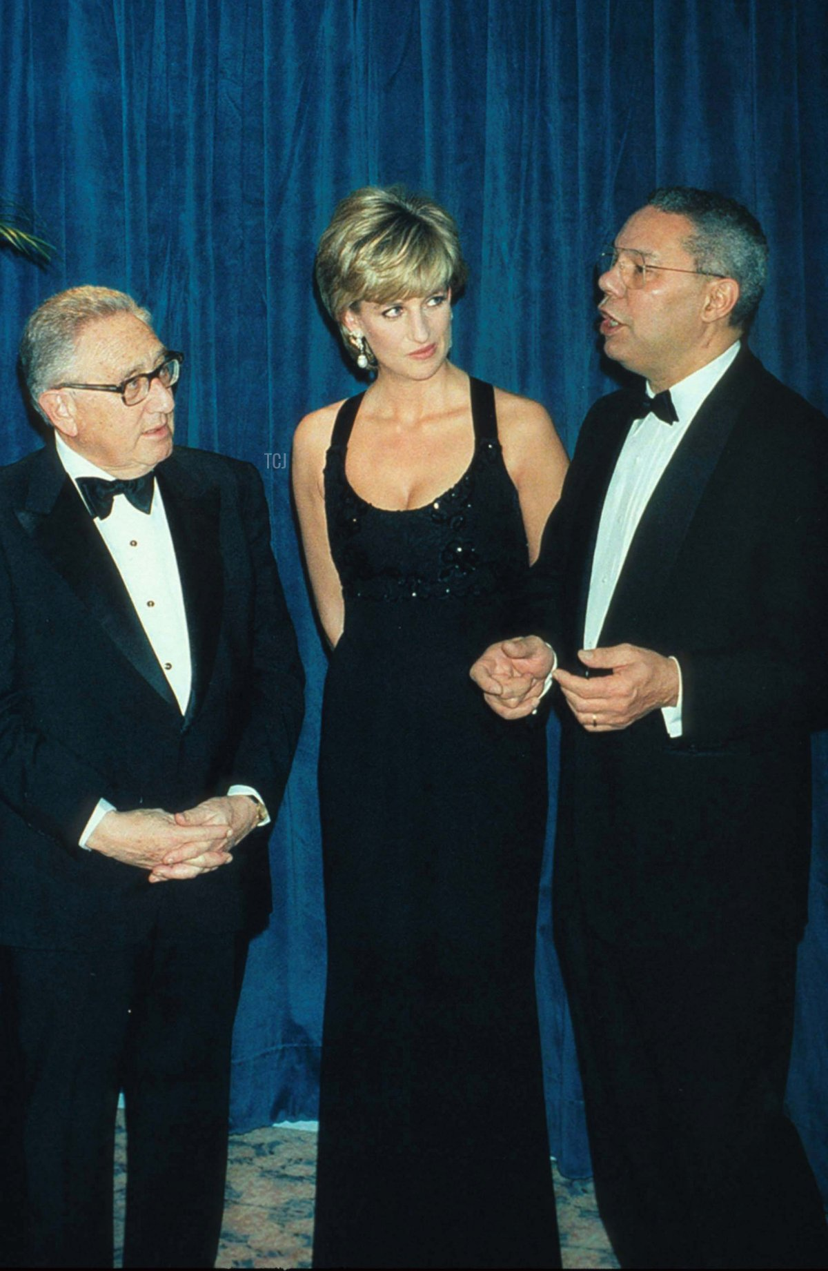 Lady Diana Spencer stands with Henry Kissinger and General Colin Powell at the 41st annual United Cerebral Palsy Awards gala December 11, 1995 in New York City. Lady Diana, the Princess of Wales, received the UCP Humanitarian Award at the fundraising evening