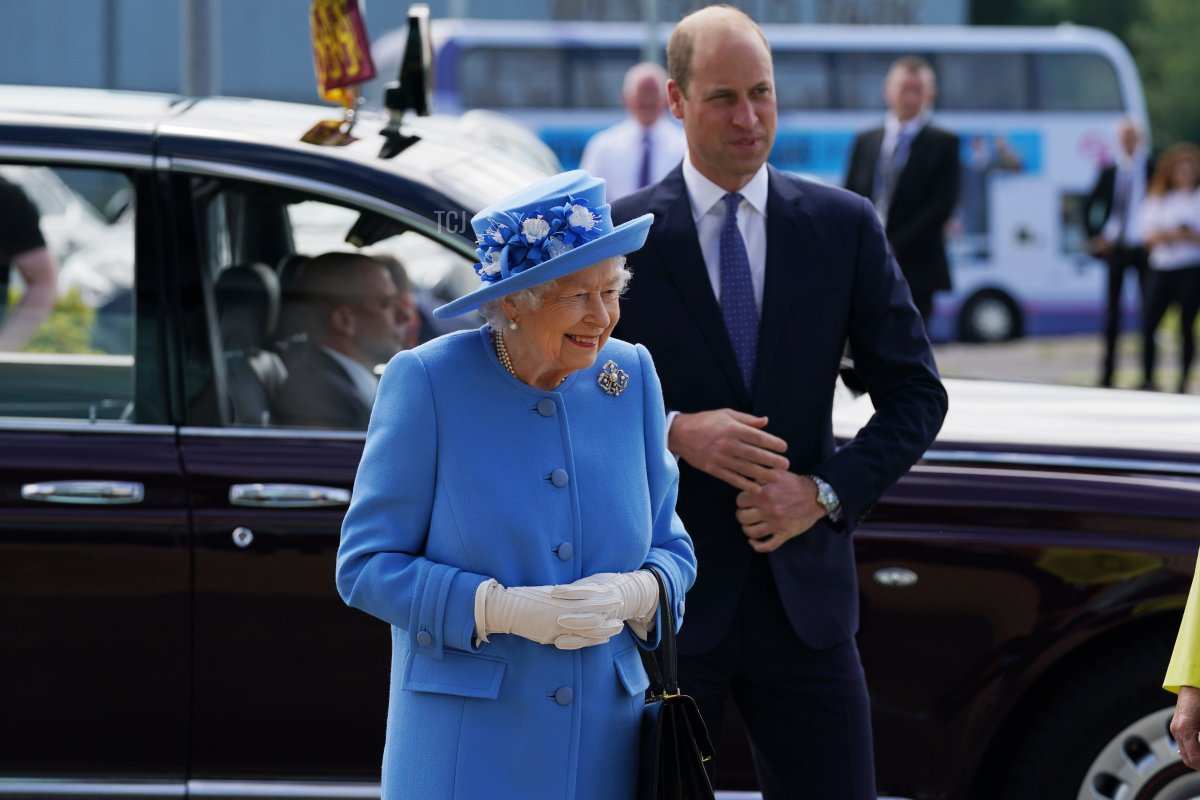 Queen Elizabeth II and Prince William, Duke of Cambridge, known as the Earl of Strathearn in Scotland, arrive for a visit to AG Barr's factory in Cumbernauld, where the Irn-Bru drink is manufactured, as part of her traditional trip to Scotland for Holyrood Week on June 28, 2021 in Cumbernauld, Scotland