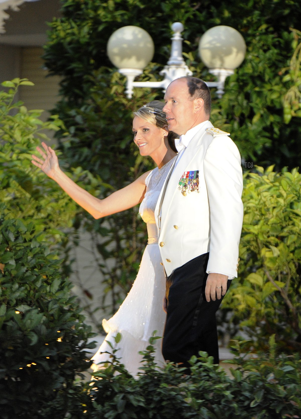 Princess Charlene of Monaco and Prince Albert II of Monaco arrive for a dinner at Opera terraces after their religious wedding ceremony on July 2, 2011 in Monaco