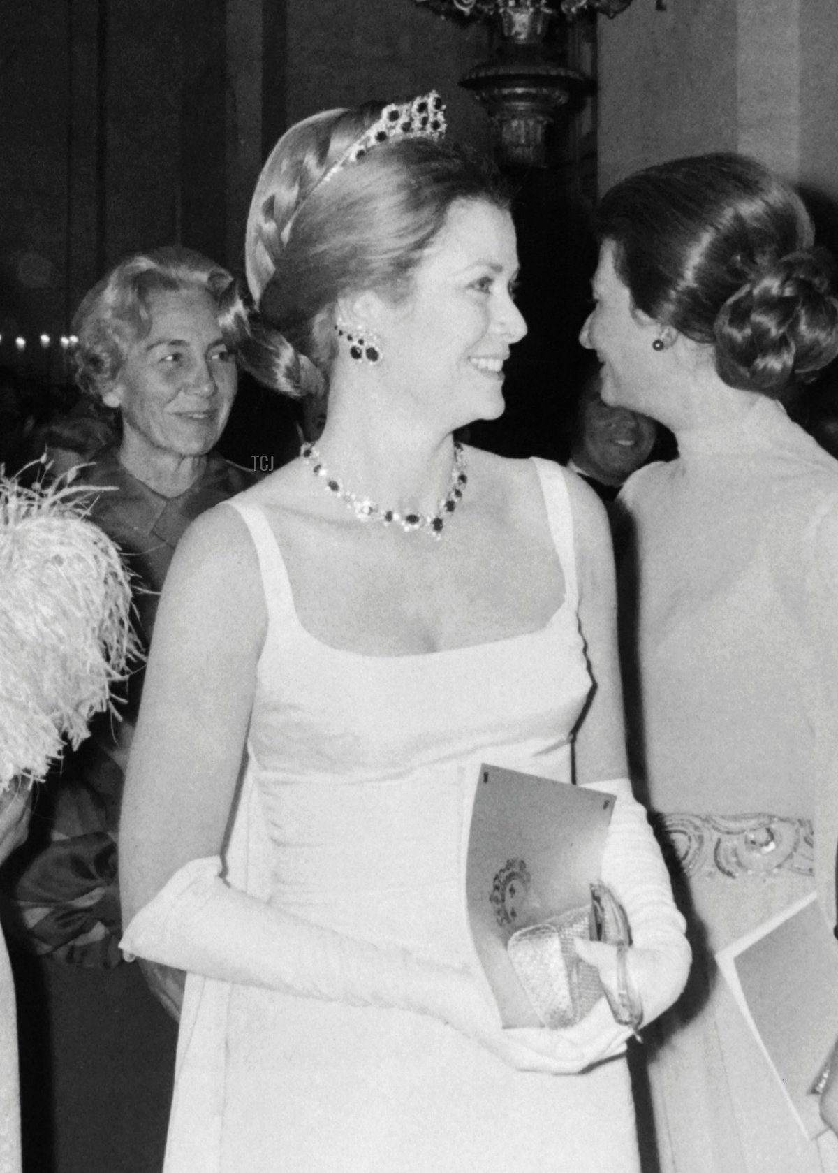 French Secretary of State Jean de Lipokowski, Baroness Philippine de Rothschild, Princess Grace of Monaco and French deputy Michel Debré attend a gala event, for the renovation of the Palace of Versailles, on November 28, 1973 in Versailles