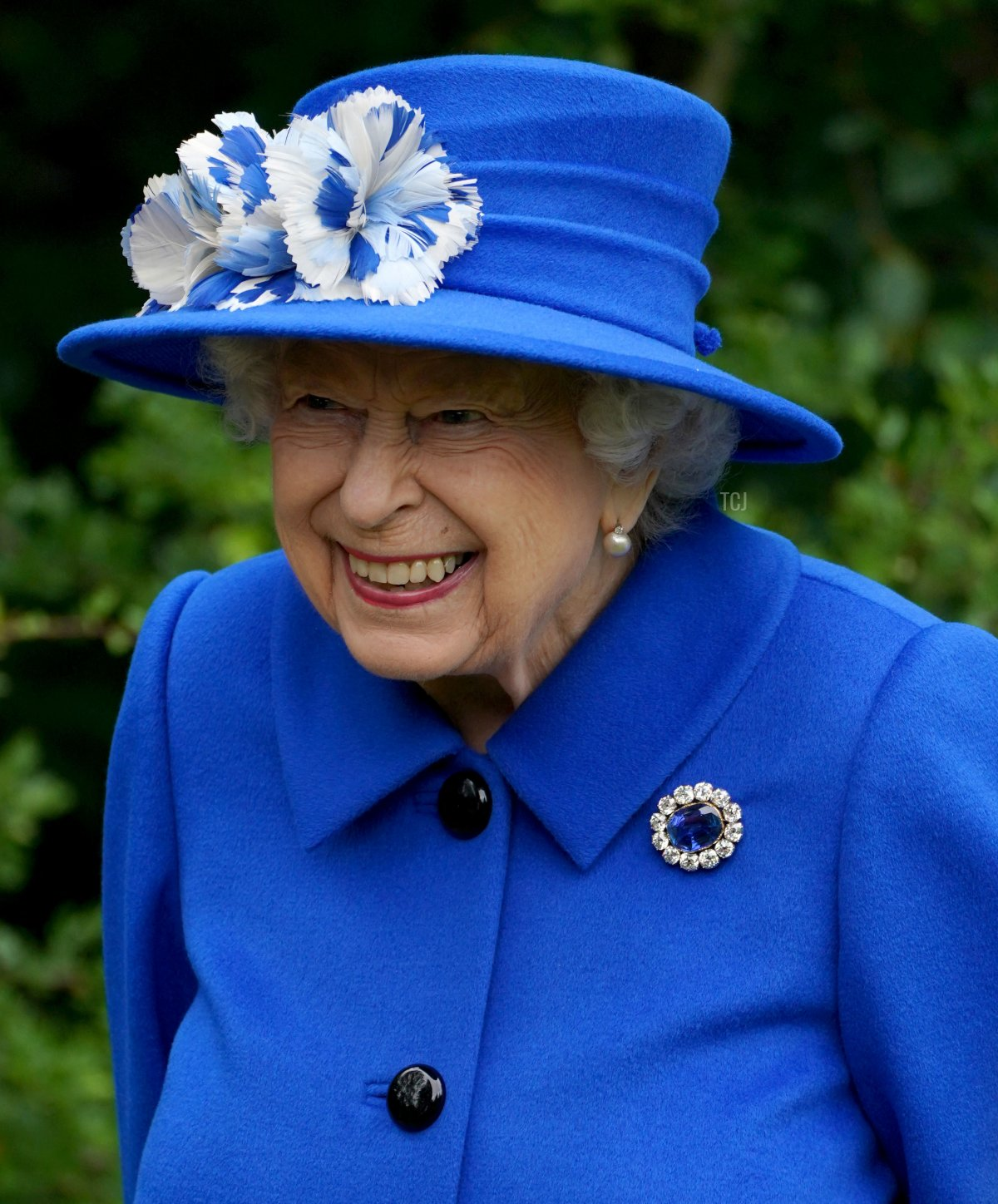 Britain's Queen Elizabeth II gestures as she meets participants during a visit to The Childrens Wood Project in Glasgow on June 30, 2021, as part of her traditional trip to Scotland for Holyrood Week