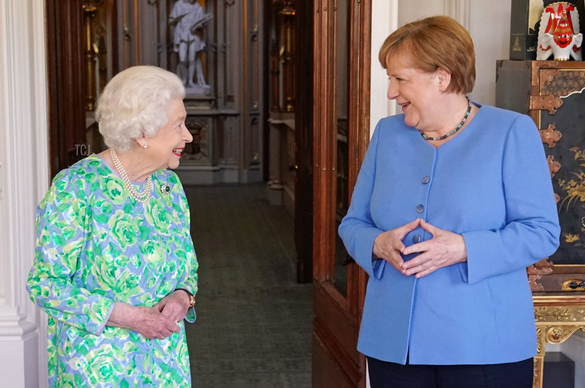 Britain's Queen Elizabeth II receives German Chancellor Angela Merkel during an audience at Windsor Castle in Windsor, Berkshire on July 2, 2021. - German leader Angela Merkel will have a new a science prize established in her honour during a farewell visit to Britain on Friday, which will also include a meeting with Queen Elizabeth II