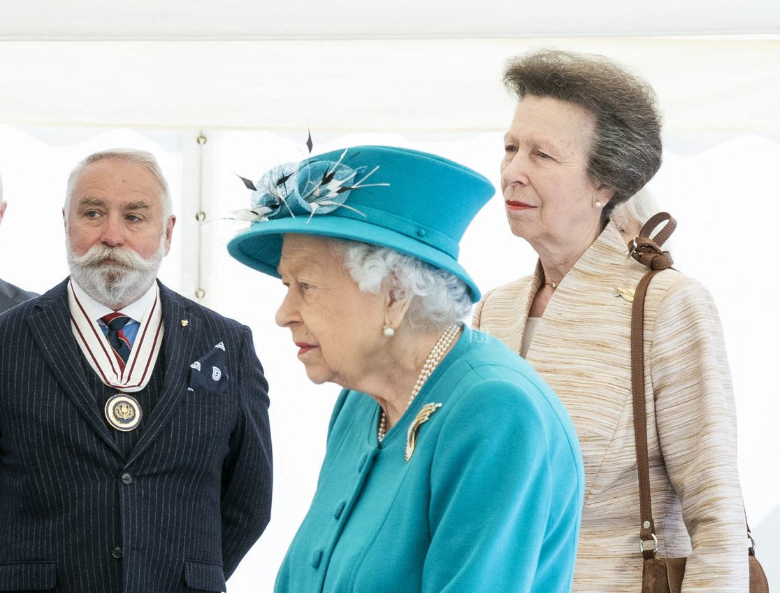 Britain's Queen Elizabeth II and Britain's Princess Anne, Princess Royal are shown a wave energy converter model during a visit to the Edinburgh Climate Change Institute at the University of Edinburgh in Edinburgh, Scotland on July 1, 2021, as part of her traditional trip to Scotland for Holyrood Week