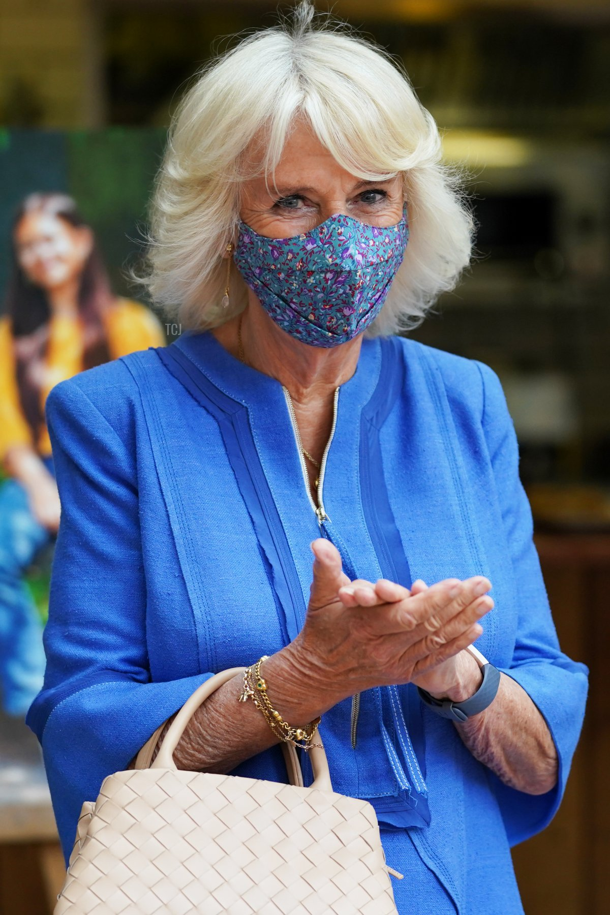 Camilla, Duchess of Cornwall, applauds a poetry recital during a visit to Booths Bookshop to meet with the organisers of the Hay Festival and tour independent shops and local businesses, as part of a week long tour of Wales for Wales Week, on July 6, 2021