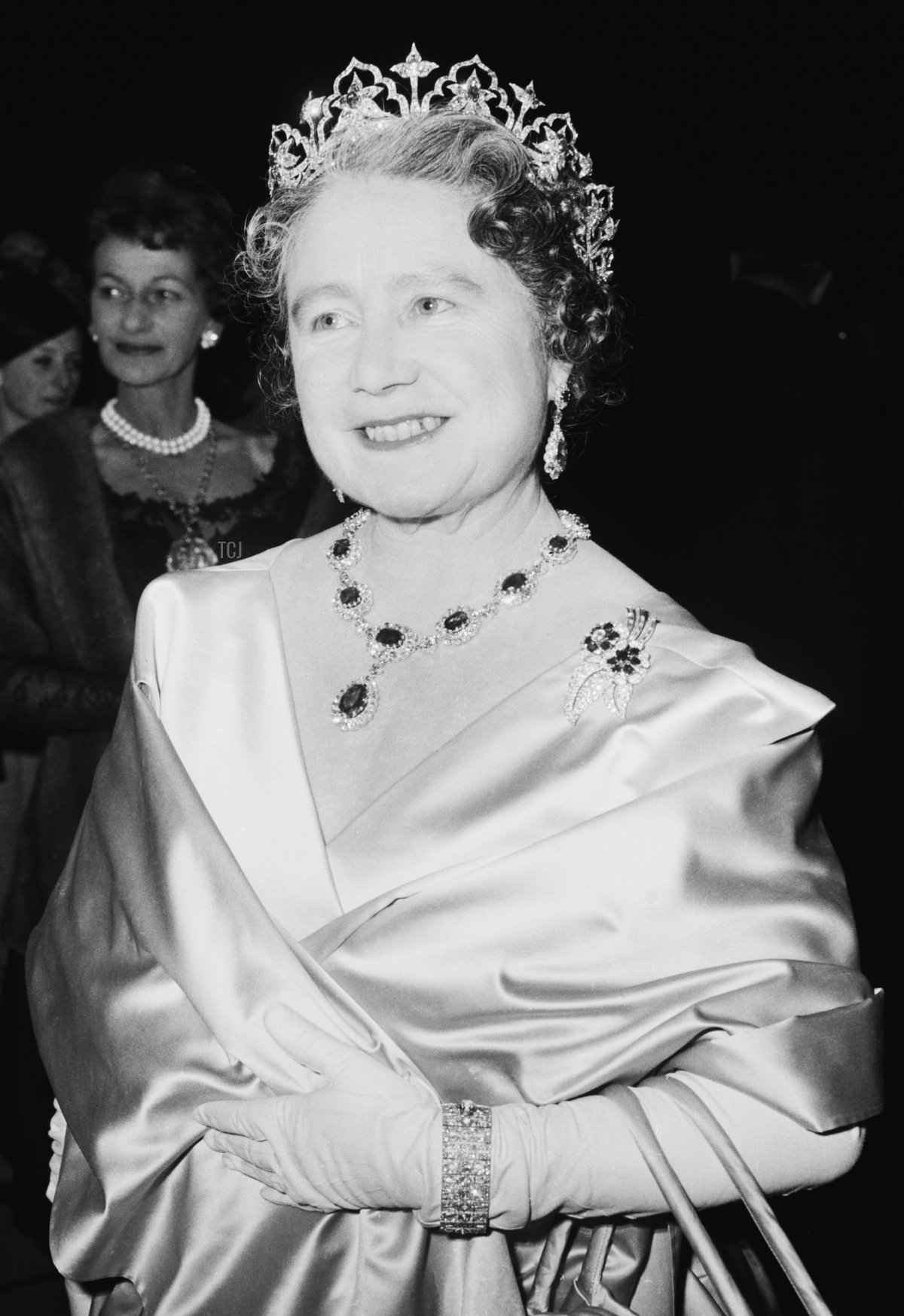 The Queen Mother (1900 - 2002) attends a performance at RADA (the Royal Academy of Dramatic Art), to celebrate the drama school's Diamond Jubilee (60th anniversary), London, UK, November 1964