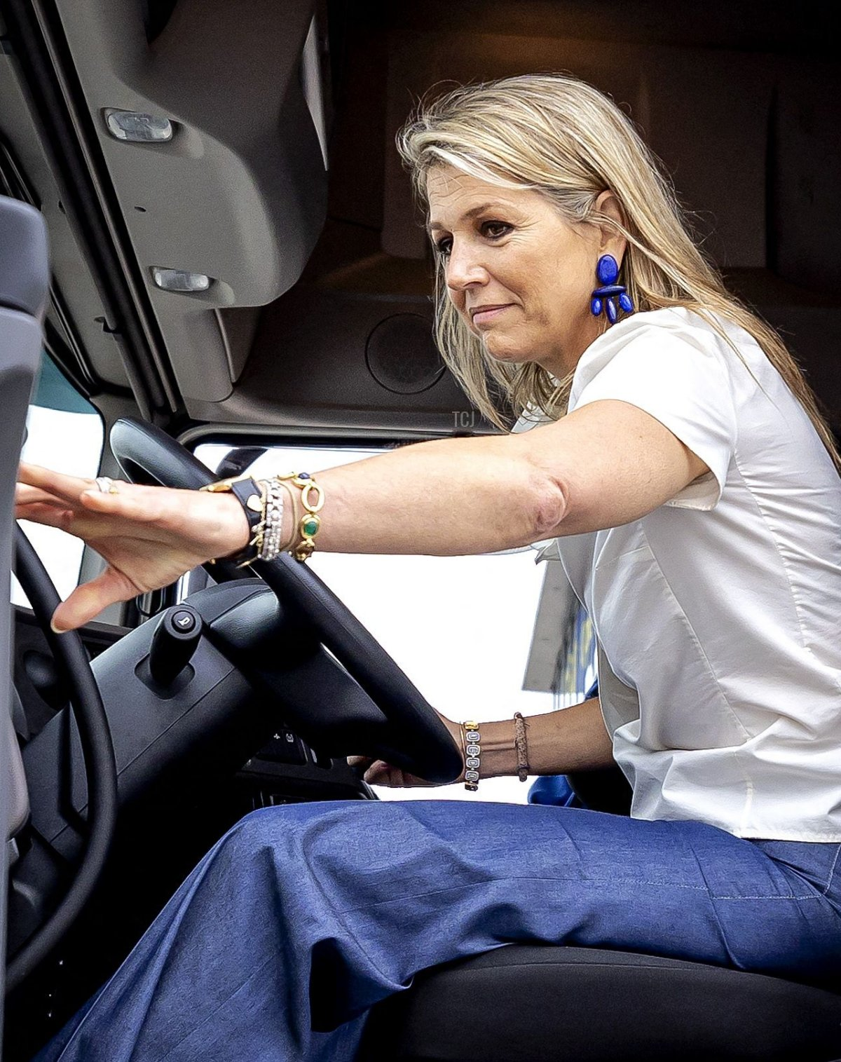 Dutch Queen Maxima drives a truck accompanied by a female instructor during a working visit to the Transport and Logistics sector in Nieuwegein, on July 14, 2021