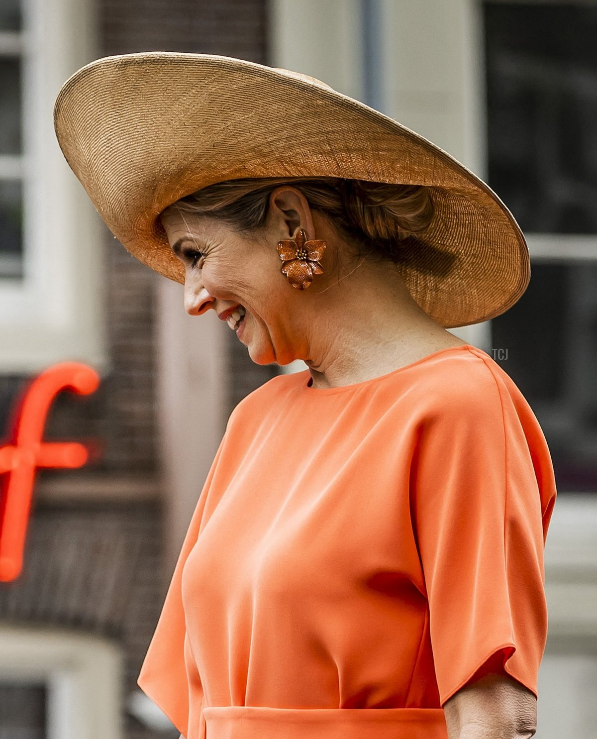 Netherlands' Queen Maxima watches a robot cutting a ribbon during the opening of a 3D-printed bridge at the Oudezijds Achterburgwal in Amsterdam on July 15, 2021