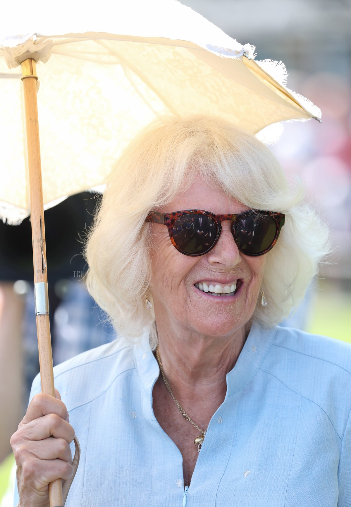 Camilla, Duchess of Cornwall attends a gathering of the town's community groups and young people in Victoria Park with Prince Charles, Prince of Wales during Day 3 of their visit to Devon and Cornwall on July 21, 2021 in Bideford, England