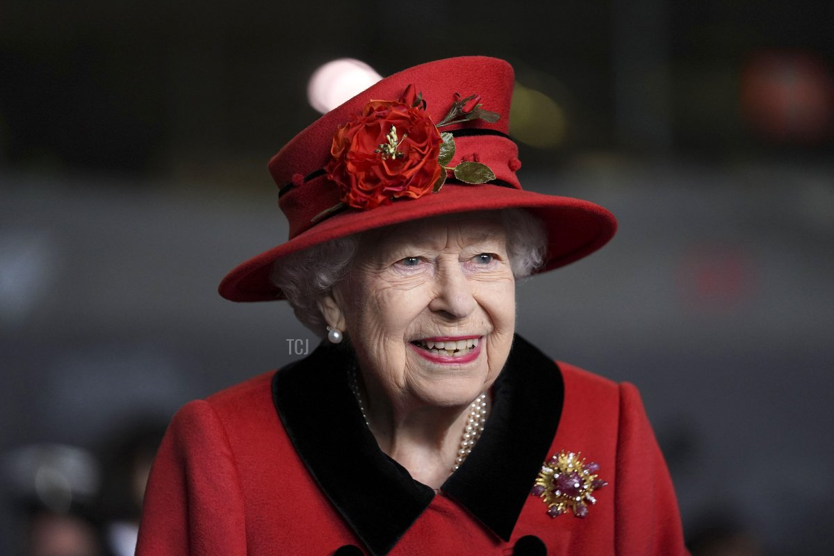 Britain's Queen Elizabeth II reacts during her visit to the aircraft carrier HMS Queen Elizabeth in Portsmouth, southern England on May 22, 2021, ahead of its maiden operational deployment to the Philippine Sea