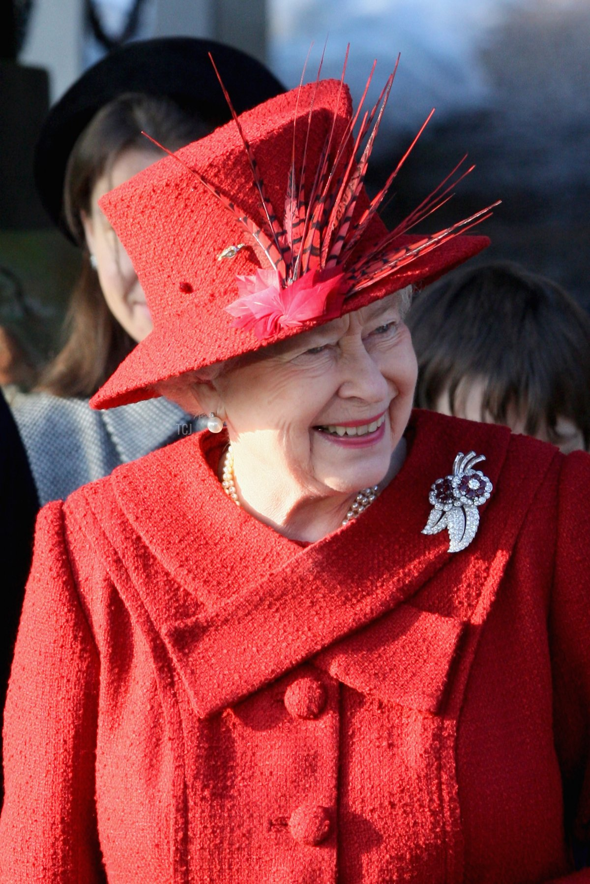 HM Queen Elizabeth II smiles as she leaves the Christmas Day service at Sandringham Church on December 25, 2009 in King's Lynn, England