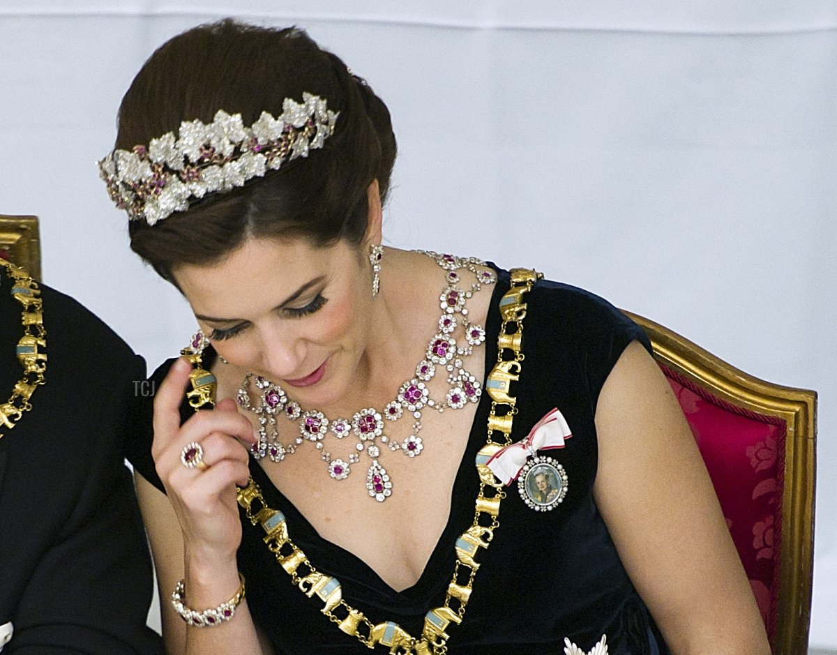 Danish Crown Princess Mary (R) and King Konstantin attend the Gala Dinner in Christiansborg Castle on the occasion of Danish Queen Margrethe's 40th jubilee on January 15, 2012