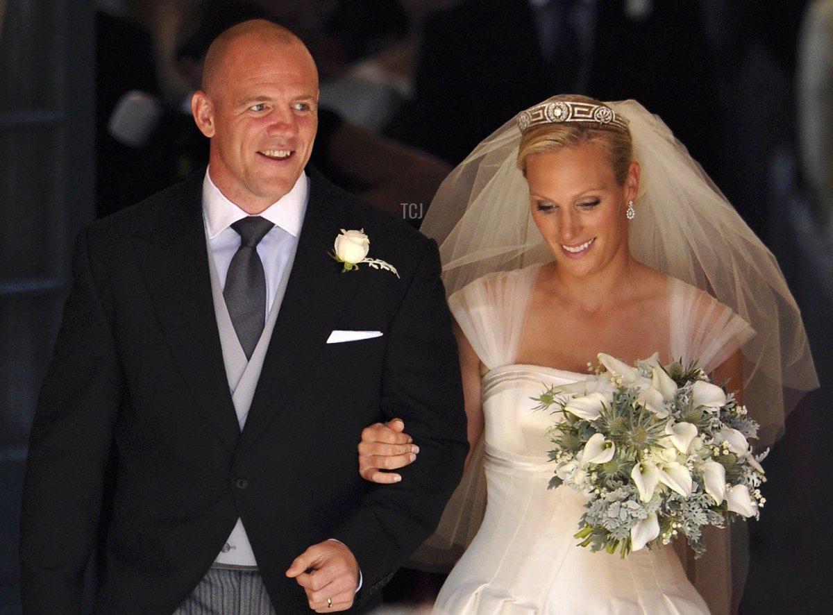 England rugby player Mike Tindall (L) and his new wife Britain's Zara Phillips, granddaughter of Queen Elizabeth II, leave after their wedding ceremony at Canongate Kirk in Edinburgh, Scotland, on July 30, 2011
