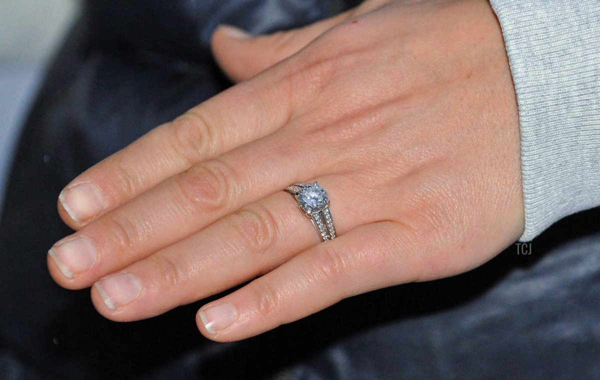 Zara Phillips, daughter of Princess Anne, and grand-daughter of Britain's Queen Elizabeth II, shows the photographer her engagement ring as she poses for a photograph with her fiance, England rugby player Mike Tindall (not pictured), after the announcement of their engagement, at their home in Gloucestershire, south west England on December 21, 2010
