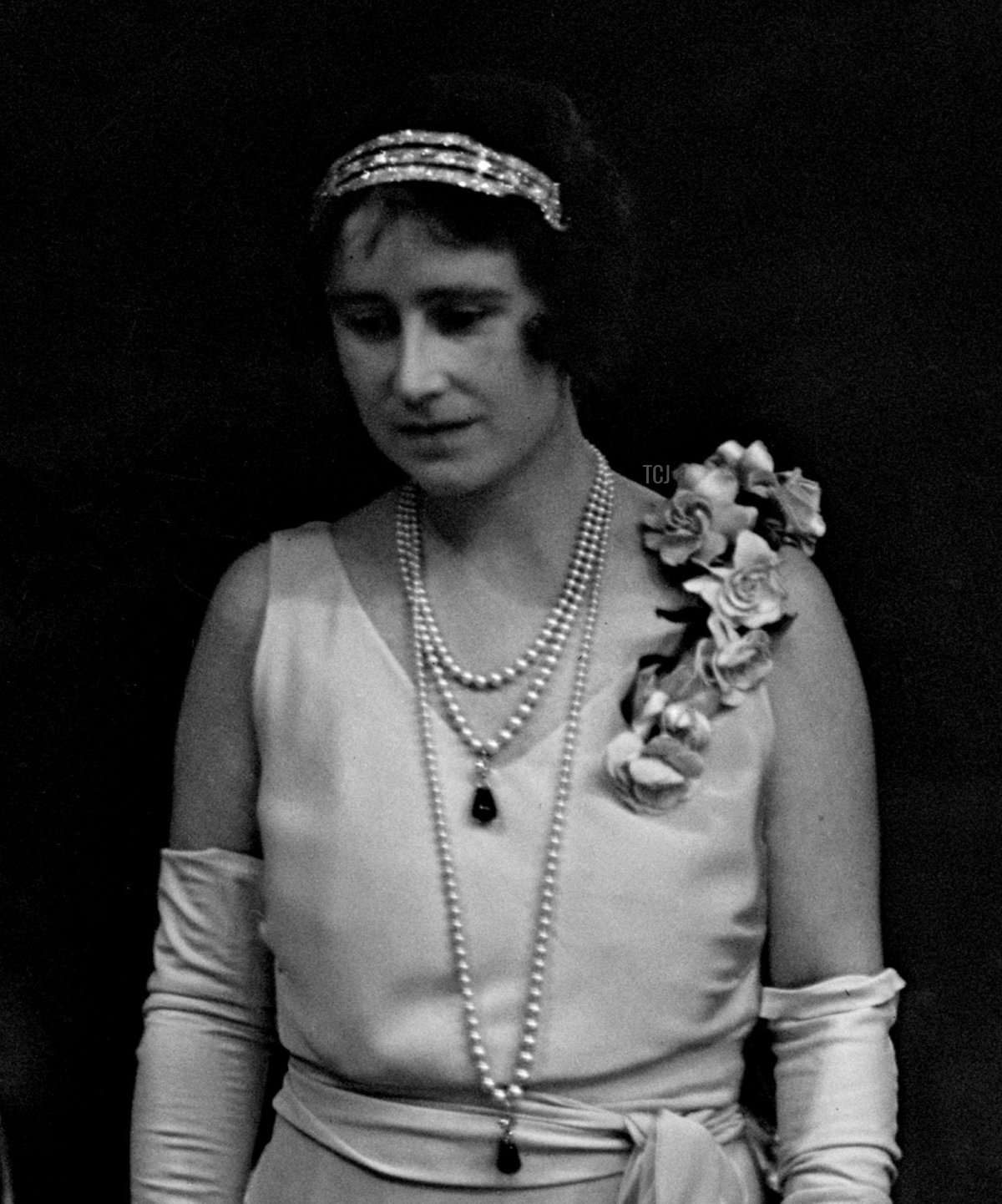The Duchess of York (later Queen Elizabeth the Queen Mother) wears her Cartier Bracelet Bandeau to attend a ballet performance at the Royal Opera House, July 1933