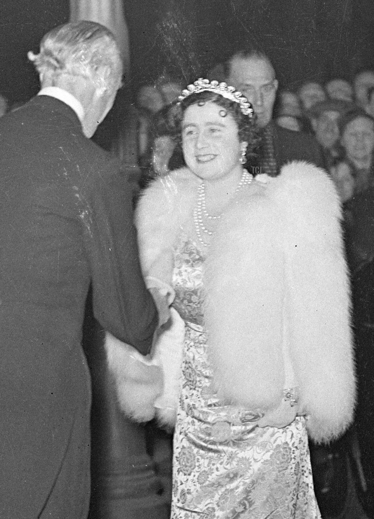 Queen Elizabeth of the United Kingdom (later the Queen Mother) wears the Cartier Halo Tiara for a special performance of Macbeth (which is, of course, set at her childhood home of Glamis Castle) at the Old Vic in aid of the Centenary Fund of the Kings College Hospital, November 1937