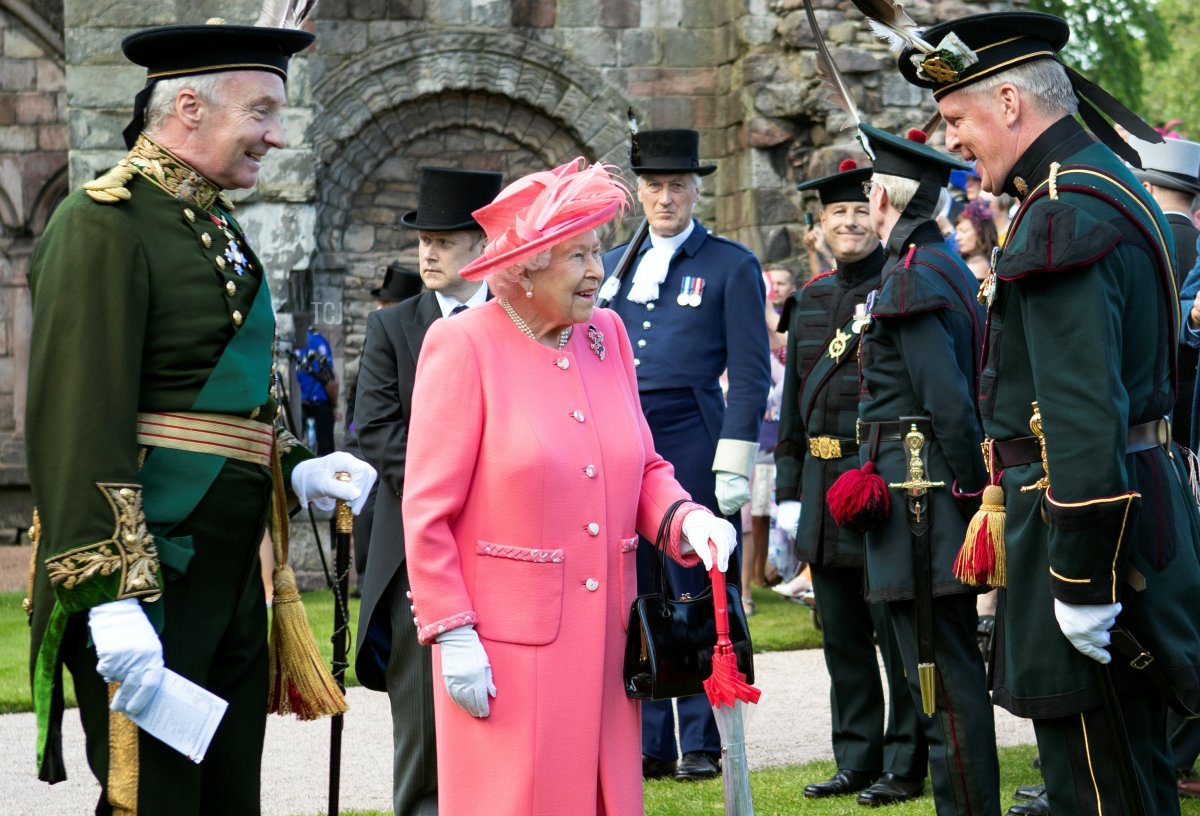 Britain's Queen Elizabeth II attends a garden party at the Palace of Holyroodhouse in Edinburgh on July 3, 2019