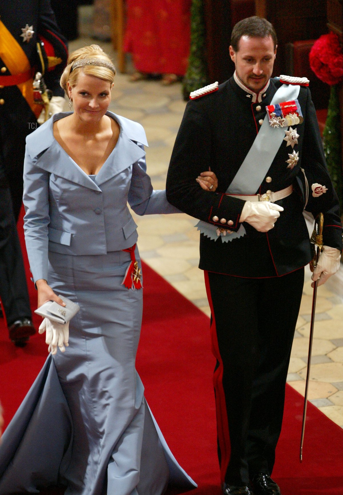 Crown Prince Haakon and his wife Crown Princess Mette-Marit of Norway arrive to attend the wedding between Danish Crown Prince Frederik and Miss Mary Elizabeth Donaldson in Copenhagen Cathedral May 14, 2004