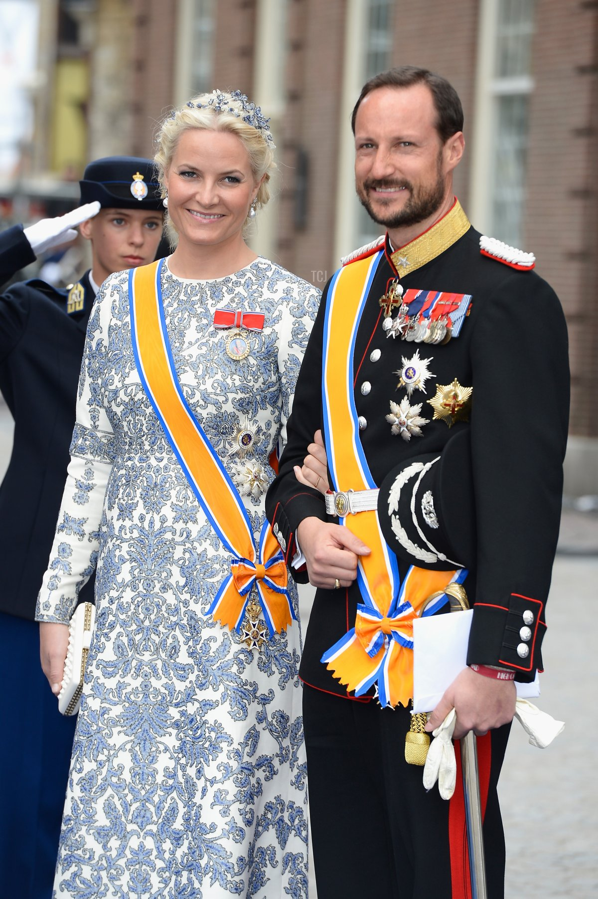 Crown Prince Haakon, and Crown Princess Mette-Marit of Norway depart the Nieuwe Kerk to return to the Royal Palace after the abdication of Queen Beatrix of the Netherlands and the Inauguration of King Willem Alexander of the Netherlands on April 30, 2013 in Amsterdam