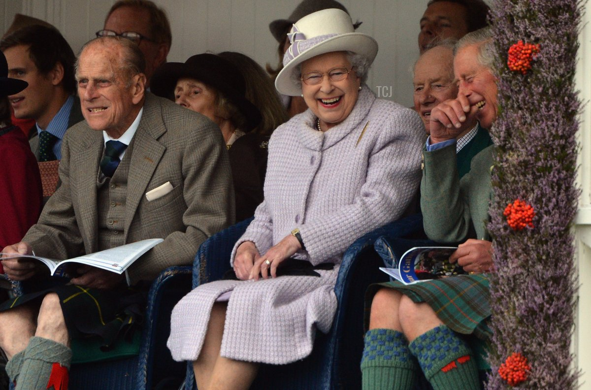 Prince Philip, Duke of Edinburgh, Queen Elizabeth II and Prince Charles attend the Braemar Highland Games at The Princess Royal and Duke of Fife Memorial Park on September 1, 2012 in Braemar, Scotland