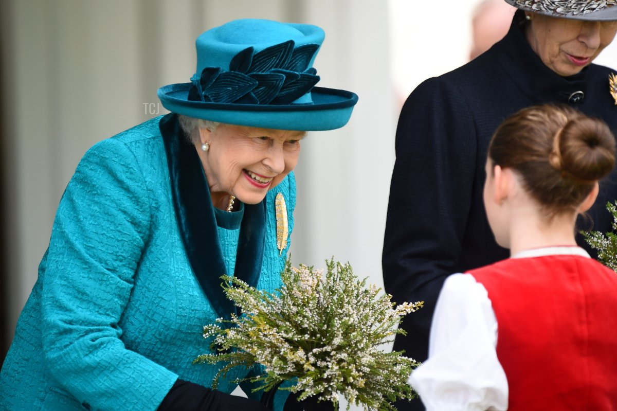 Britain's Queen Elizabeth II receives a bouquet on her arrival at the annual Braemar Gathering in Braemar, central Scotland, on September 1, 2018