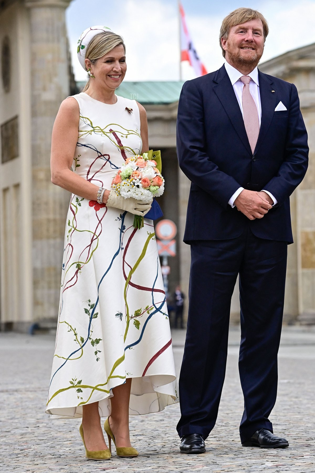 King Willem-Alexander and Queen Maxima of the Netherlands pose for photos in front of the landmark Brandenburg Gate in Berlin on July 5, 2021