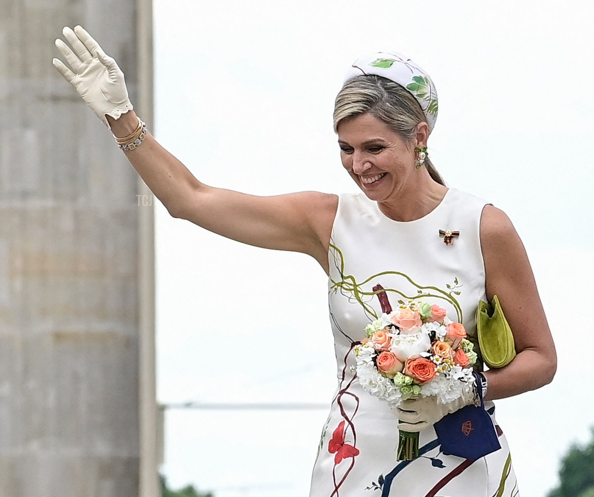 King Willem-Alexander and Queen Maxima of the Netherlands wave in front of the landmark Brandenburg Gate in Berlin on July 5, 2021