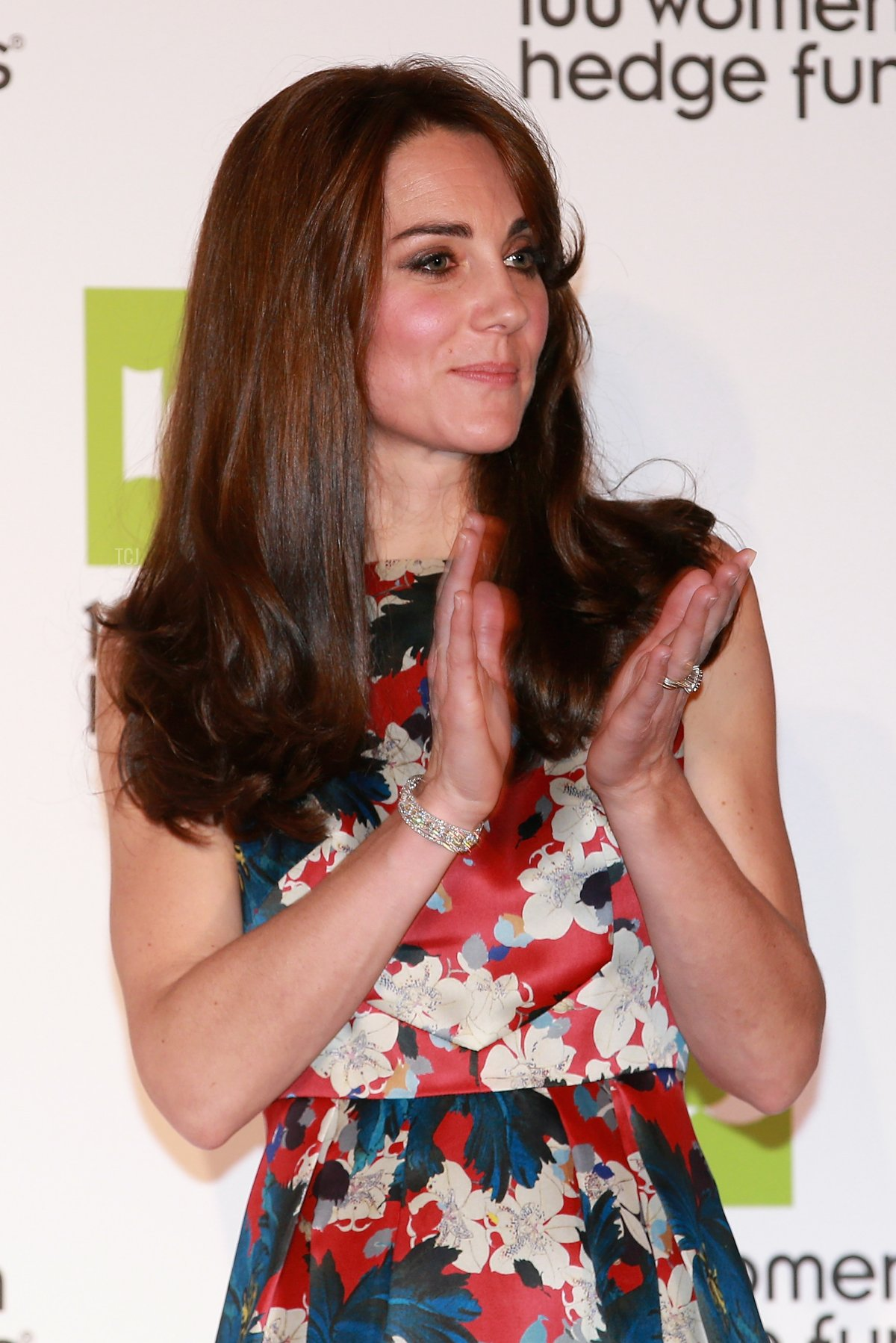 Catherine, Duchess of Cambridge claps Elizabeth Corley CEO of Allianz Global Investors on to stage at the 100 Women In Hedge Funds Gala Dinner In Aid Of The Art Room at the Victoria and Albert Museum on October 27, 2015