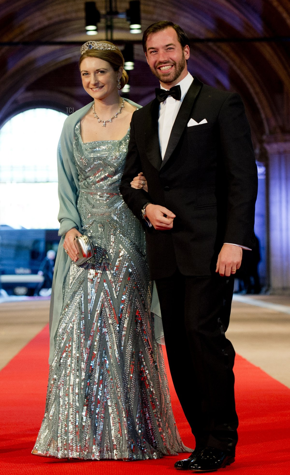 Luxembourg's Grand Duke Guillaume (R), his wife Grand Duchess Stephanie pose on April 29, 2013 as they arrive to attend a dinner at the National Museum (Rijksmuseum) in Amsterdam hosted by Queen Beatrix of the Netherlands on the eve of her abdication