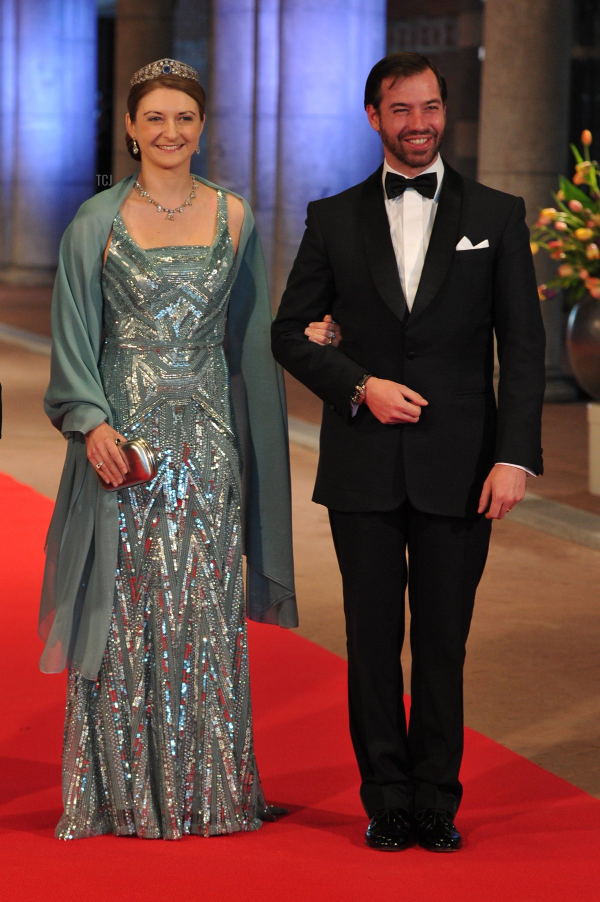 Luxembourg's Grand Duke Guillaume (R) and his wife Grand Duchess Stephanie pose on April 29, 2013 as they arrive to attend a dinner at the National Museum (Rijksmuseum) in Amsterdam hosted by Queen Beatrix of the Netherlands on the eve of her abdication