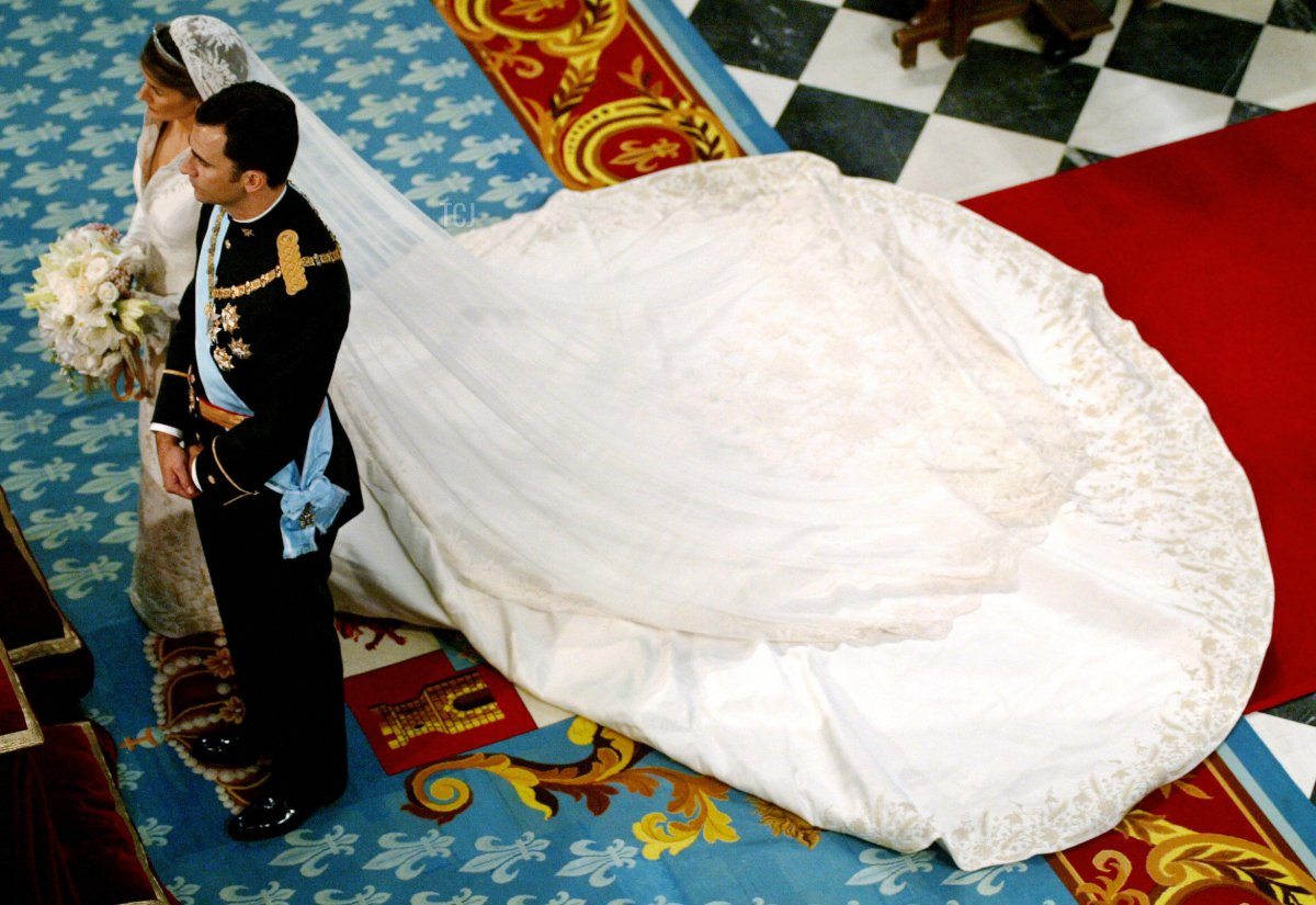 Spanish Crown Prince Felipe (R) and the Princess of Asturias Letizia Ortiz stand as they get ready to place Ortiz's bridal bouquet at Madrid's Basilica of Atocha May 22, 2004