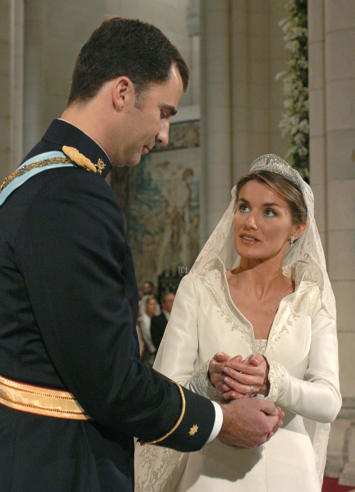 Spain's Crown Prince Felipe de Bourbon stands next to bride Letizia Ortiz as they marry in Almudena cathedral May 22, 2004 in Madrid