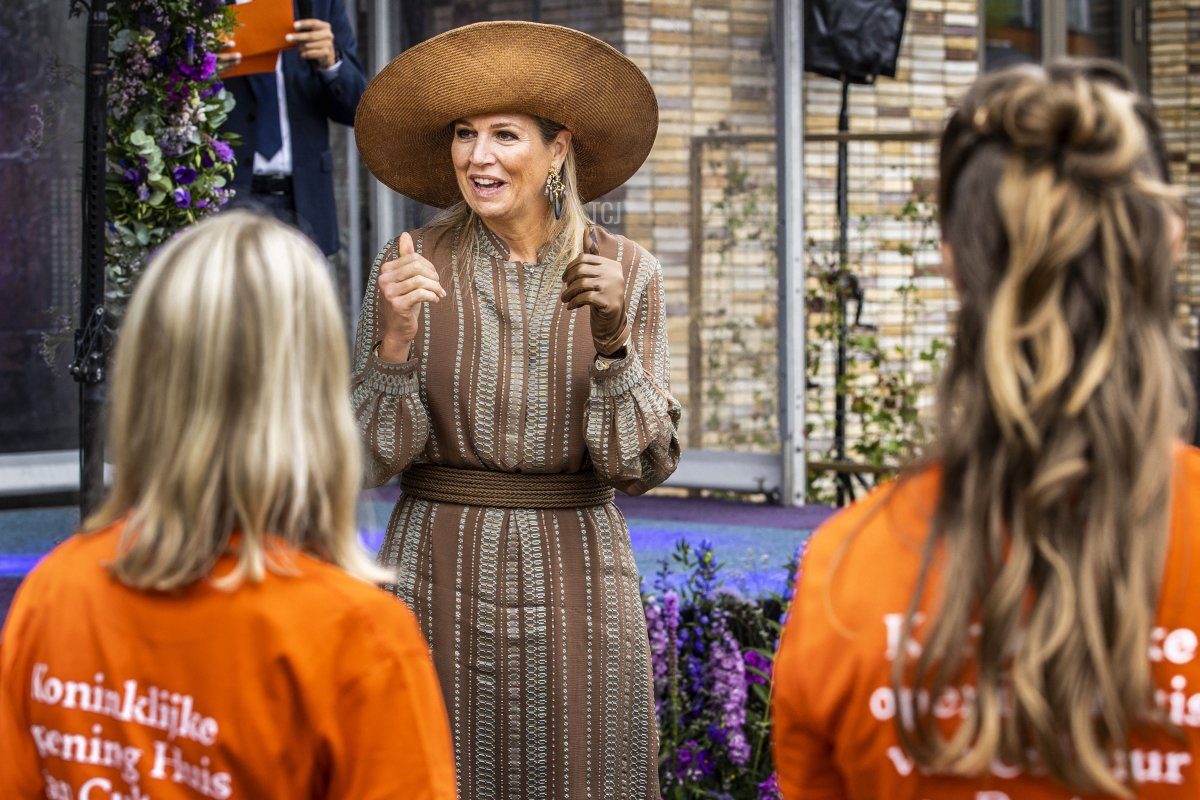 Queen Maxima speaks with primary school students as she arrives for a visit at the House of Culture and Administration of the municipality of Midden-Groningen on September 15, 2021