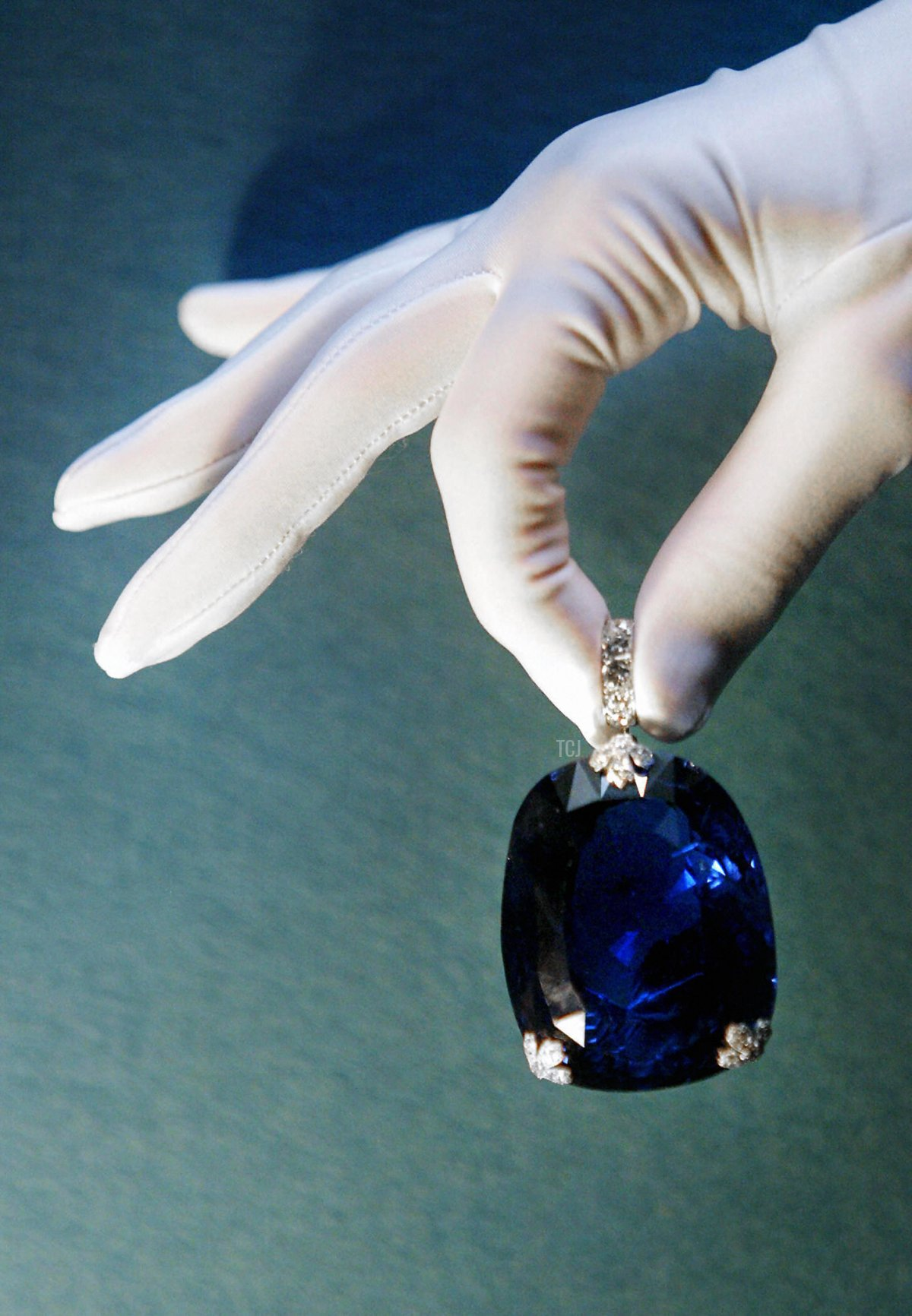 A woman holds a 478 carat sapphire which was previously owned by Queen Marie of Romania 08 October 2003 at Christie's in London