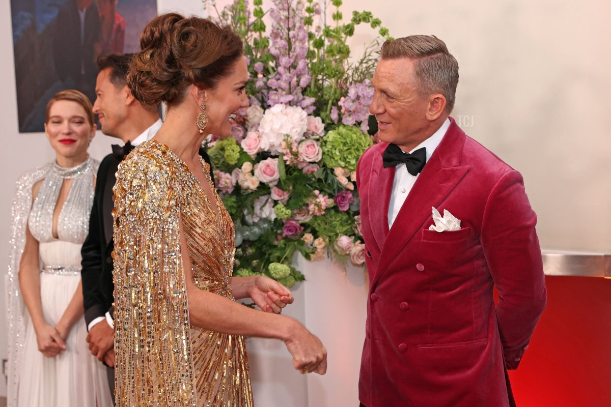 """Britain's Catherine, Duchess of Cambridge (L) meets with English actor Daniel Craig ahead of the World Premiere of the James Bond 007 film """"No Time to Die"""" at the Royal Albert Hall in west London on September 28, 2021"""