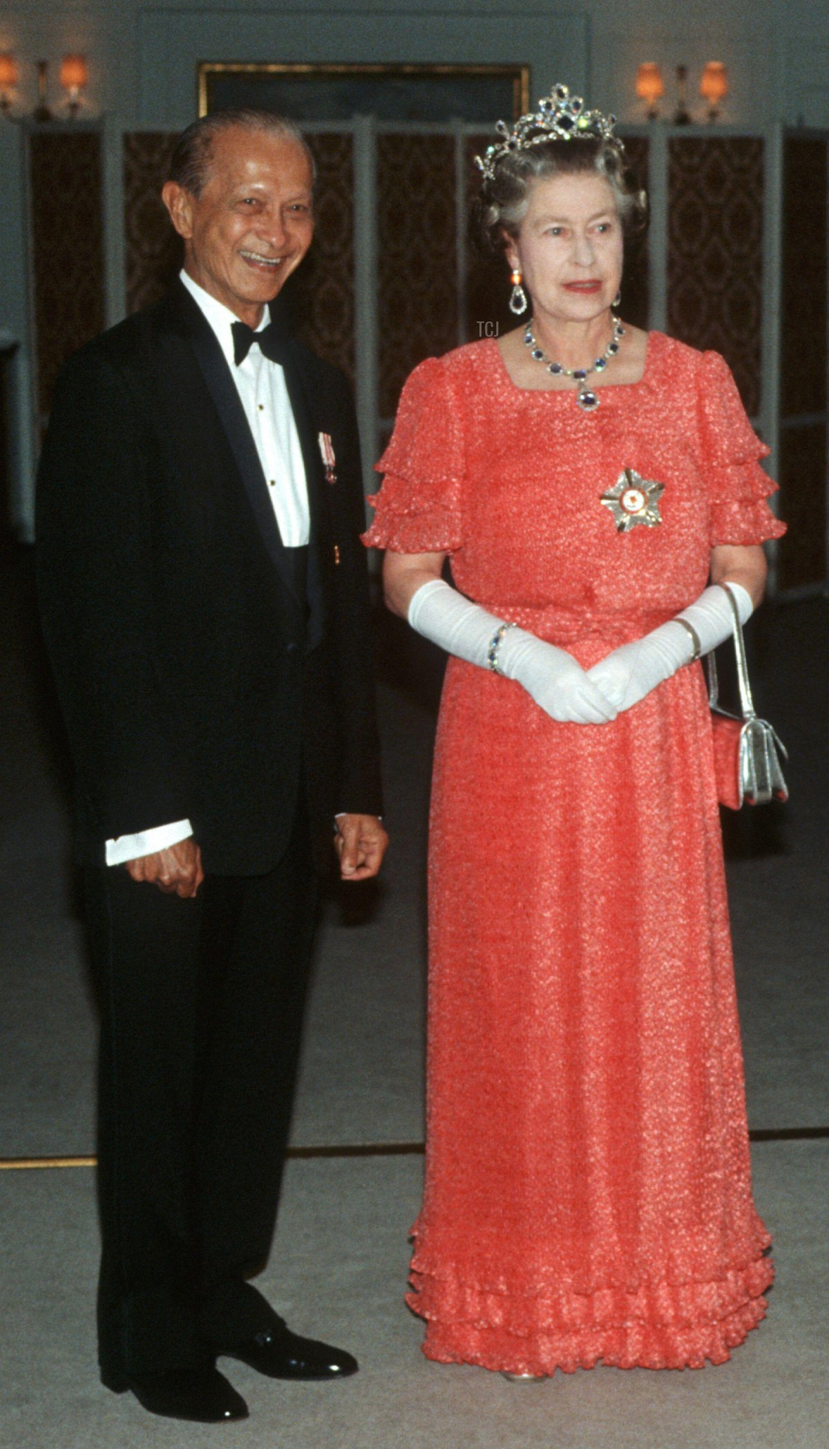 Singapore President Wee Kim Wee and HM Queen Elizabeth II arrive for dinner aboard HMY Britannia, Singapore